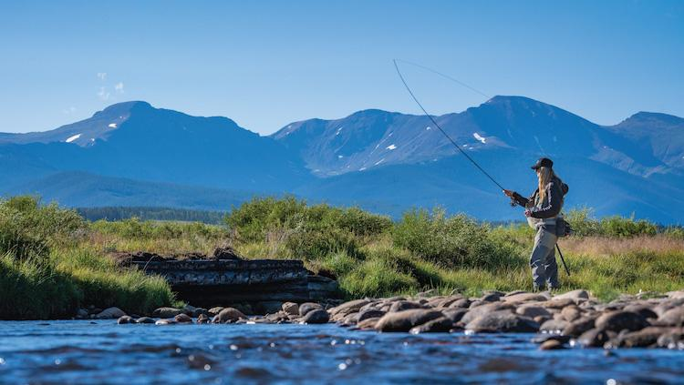 Woman fly fishing in the Colorado River