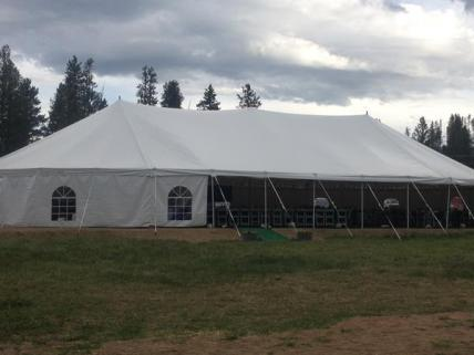 Our 2,500 sq ft tent has sides that can be rolled up or left down