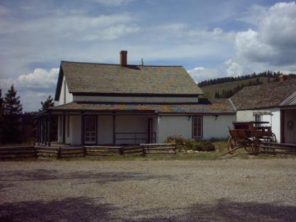 Find Cozens Ranch Museum along Hwy 40 -- a white with green historic building.