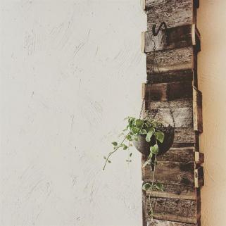Rustic barnwood accents the walls.