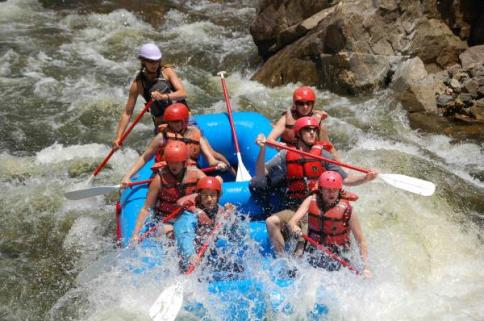 Going through the rapids with MAD Adventures