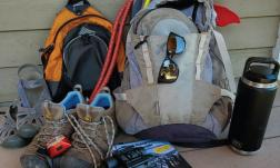 Hiking gear laid out in preparation for a summer trip