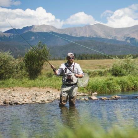 Man fly fishing in a mountain stream