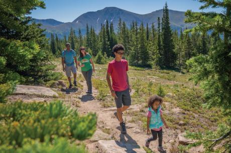 Family enjoying a mountain hike
