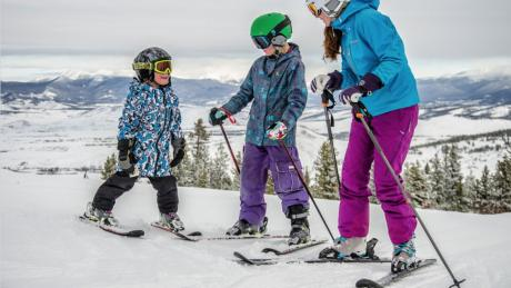 Family of skiers pausing to take in the view from Granby Ranch