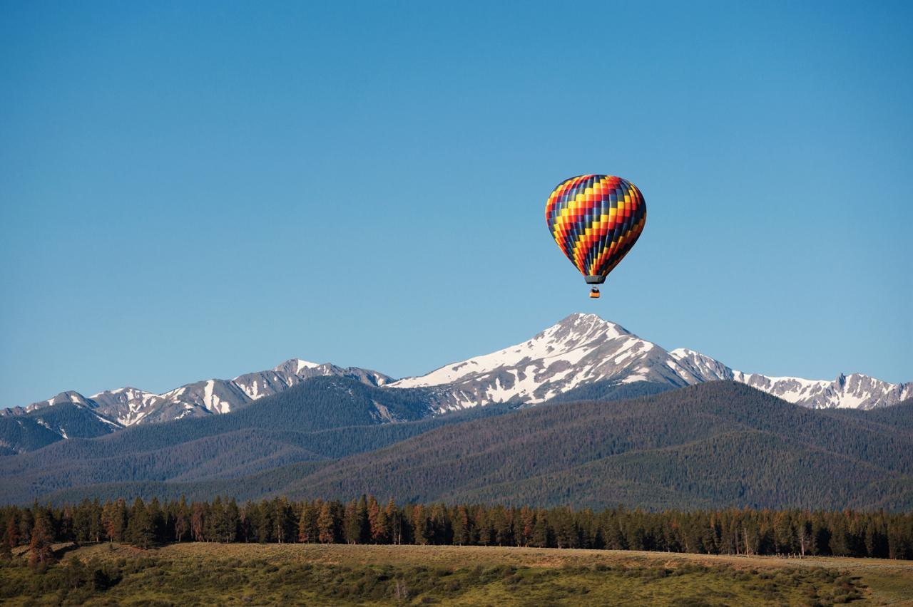 Year-round Hot Air Balloon Rides over Snow-capped peaks in winter Park and Rocky Mountain National Park
