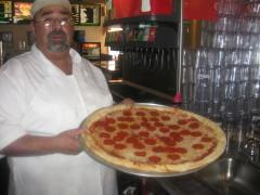Chef Frank bringing out a Pepperoni Pie