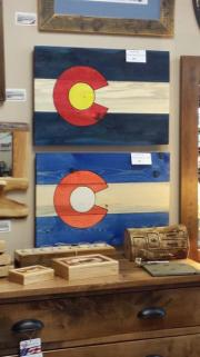 Hand made CO flags using local beetle pine wood.