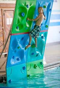 Our indoor pool offers a slide, aqua climbing wall and a sauna