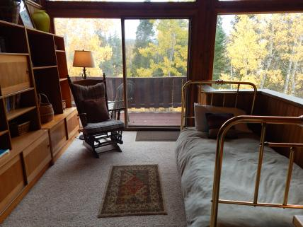 Upstairs sitting area in loft and access to private deck