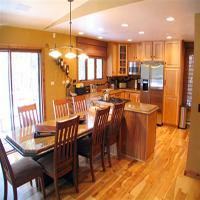 Sample photo of a dining and kitchen area in our private homes