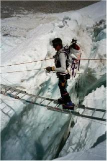 crossing crevasse in Khumbu glacier