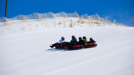 sledding tubing courtesy of winter park lodging company - Christmas Mountain Tubing